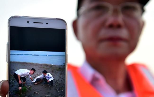 安徽:昔日专业捕鱼人 变身江豚守护者