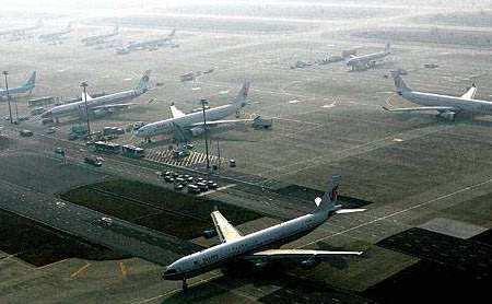 李强:打造同卓越全球城市匹配的航空枢纽