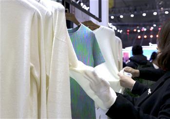 毛衫时尚闪亮国际服博会